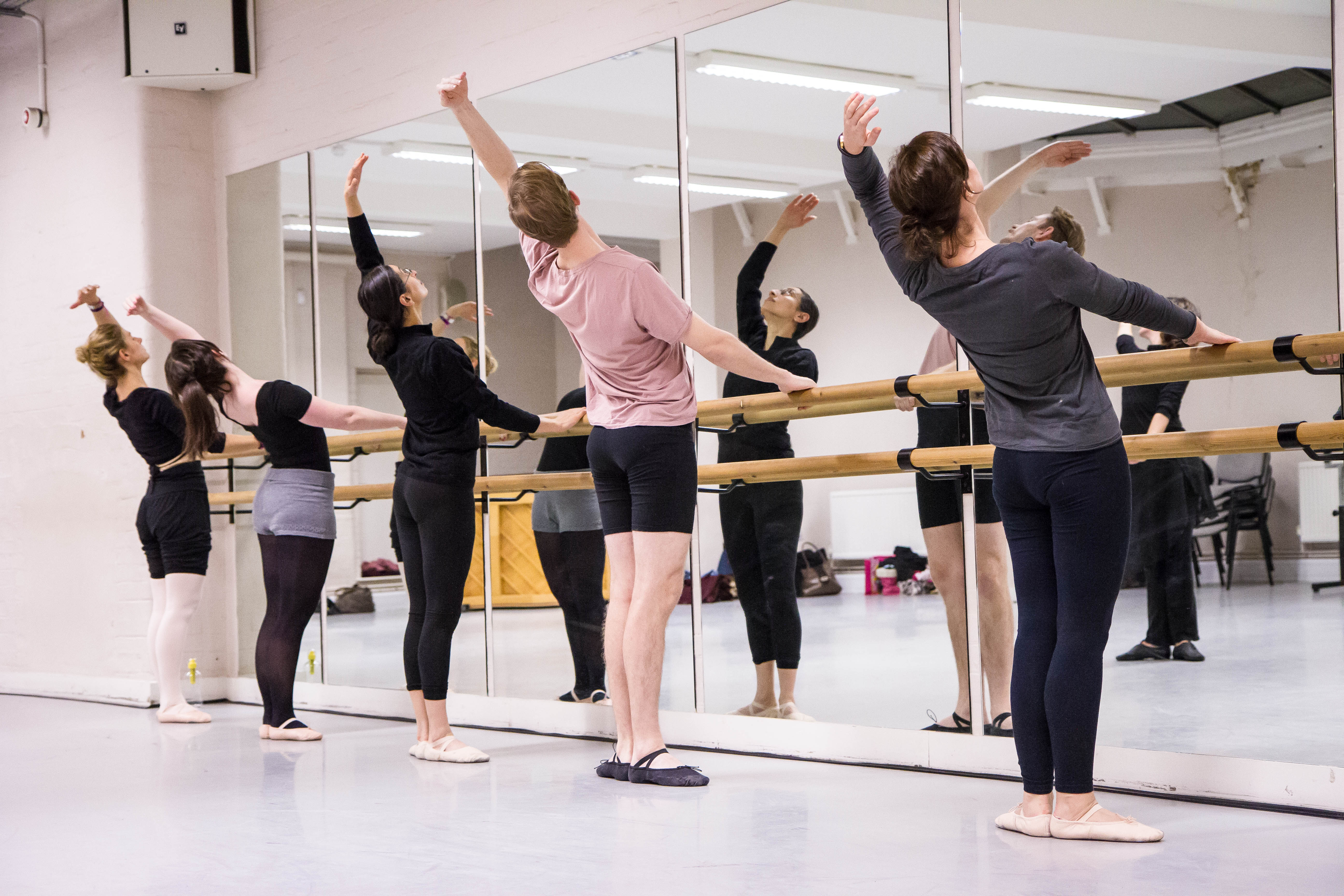 A ballet class practicing at the barre in one of our Beginner classes.