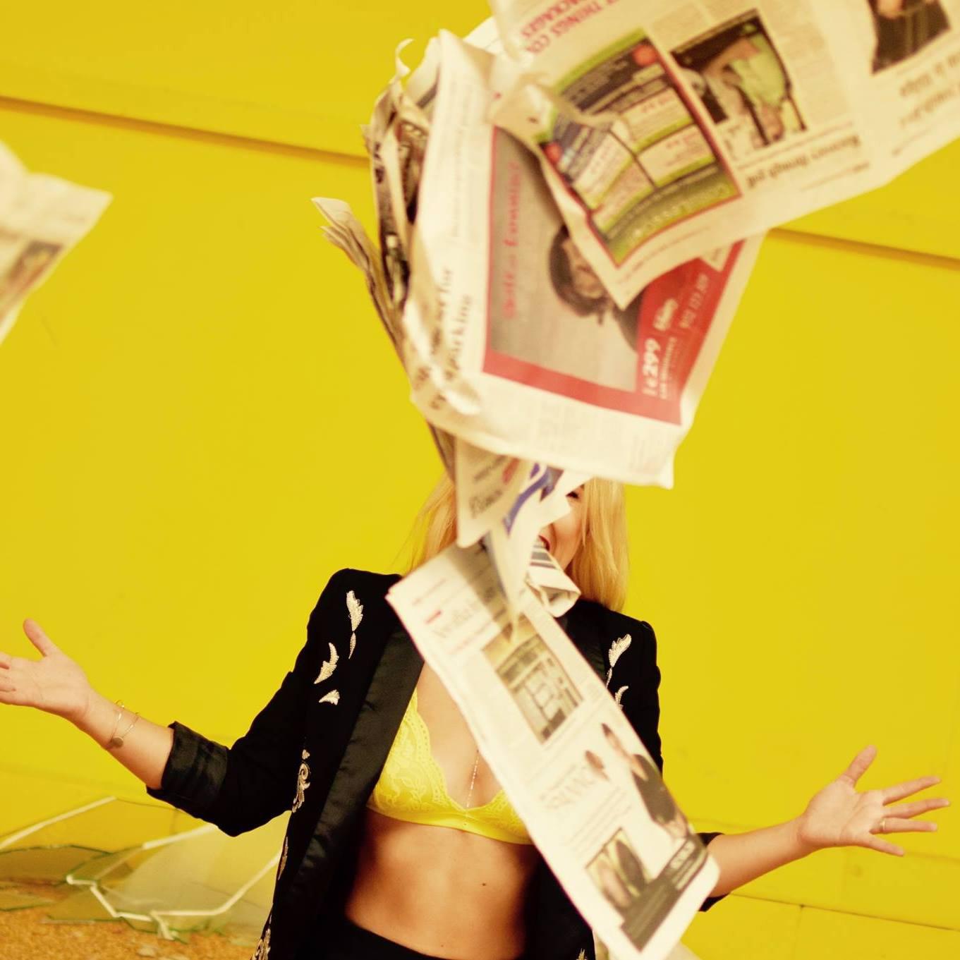 student image - raining newspapers