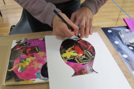 student working on art