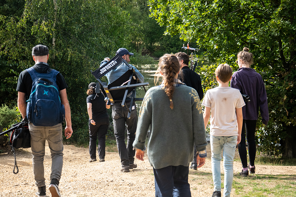 The Age of Reason cast and crew walking to set