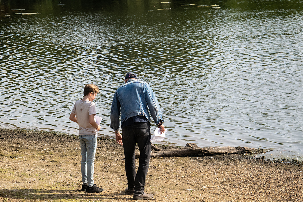 Lead actor Joel and director Tom on location discussing a scene