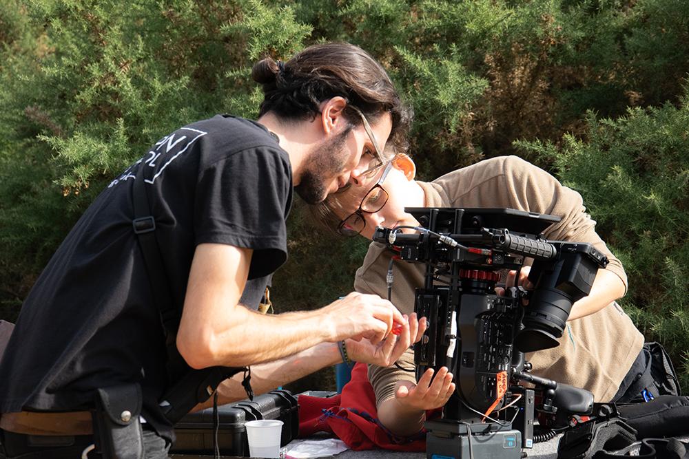Pierro Cioffi and Chloe Delaplace prepping equipment